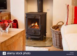 cozy modern interior living room with wood burner stock photo