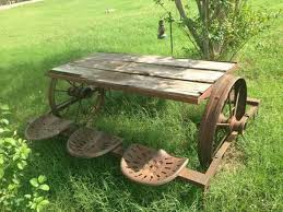 love this picnic table made out old farm equipment thinking matt