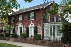 red brick colonial architecture style this beautiful home is