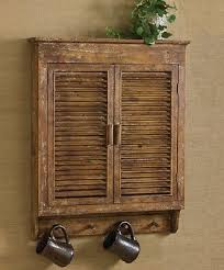 Shabby Chic Wall Shelves by Shabby Chic Furniture Cabinet Distressed Wood Shutter Wall Shelves