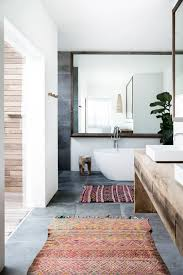 Rust Bathroom Rugs Sleek Bathroom With A Rustic Wood Vanity And Colorful Rugs