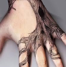 black tree on wrist tattoos black tree