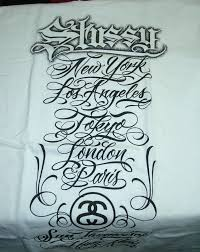 x tattoo like scripts on t shirt by mister cartoon various