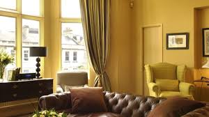 primitive bedroom decor wood floor classic pouffe green leather