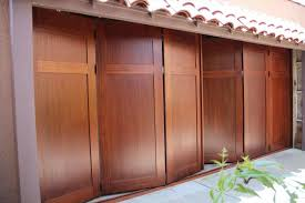 jen weld garage doors folding garage doors special routed design rundum meir biparting