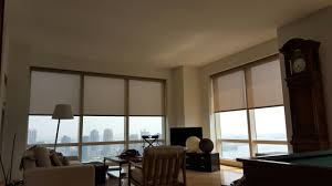 electric roller shades by ny city blinds adorn the windows of this
