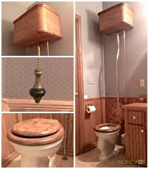 antique toilet with wall mounted tanks and pull chain flush