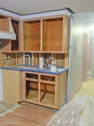 painting my oak kitchen cabinets white how to paint oak cabinets and hide the grain step by step