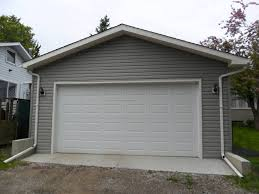 Overhead Shed Door by Garage Builder Calgary Concrete Armour Construction