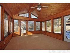 a three season porch on a scribed western red cedar log home http