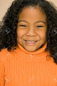 pacific islander hairstyles pacific islander girl with curly hair stock photo picture and