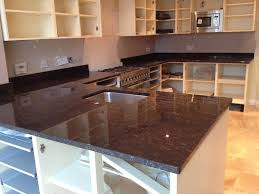 granite countertop stainless cabinet pulls blue kitchen wall