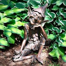 grinning and winking pixie garden ornament statue