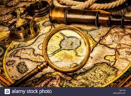 World Map Watch Vintage Compass And Telescope On Ancient World Map Stock Photo