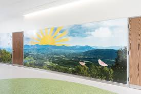 creating wall murals built to last at shriners hospitals polyvision large view of kentucky landscape mural on decorative wall cladding displaying illustrations of a sun and