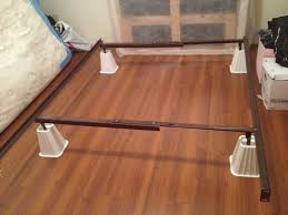 metal bed frame on white bed risers for extra under the bed