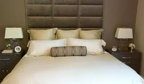 bedroom brown tufted headboard with blue wall scheme modern