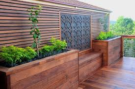merbau decking with a custom made screen planters and built in