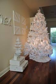 white tree with gold and silver decorations home