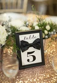 black tie party favors the smarter way to wed gold tablecloth black tie and table numbers