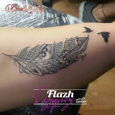 the 25 best feather tattoo wrist ideas on pinterest peacock