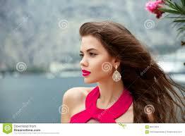 earring girl beautiful girl with wavy hair and fashion earring