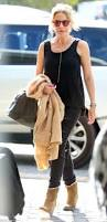 kylie minogue works off duty style as she jets out of australia