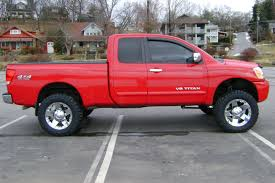 red nissan frontier lifted 6