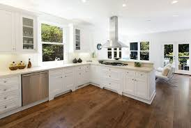 white kitchen cabinets wood floors hardwood floors in the kitchen pros and cons white