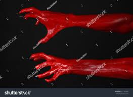 halloween black background red devils hands red hands satan stock photo 217142989 shutterstock