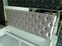 Headboard With Mirror by A Mirrored Prism Bed Being Made With Silver Tufted Velvet