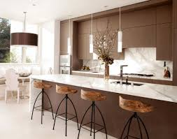 kitchen brown kitchen cabinet with white marble backsplash and