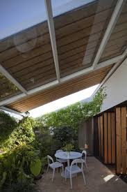 architecture retractable roof design with sloping glass roof