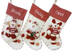red and white candy cane like reindeer christmas stocking