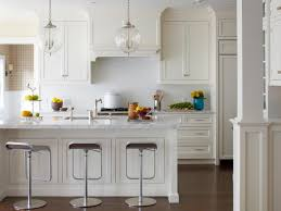 superb white kitchen design with simple lighting and wooden table