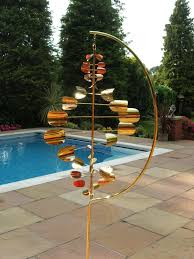 copper and brass wind dancers and wind spinners crafted by