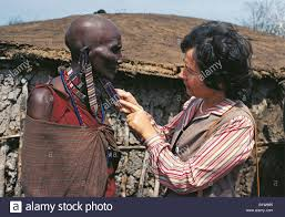 white tourist caucasian admiring maasai s ear ornaments
