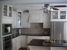 kitchen maid cabinet colors what s the better off white kraftmaid canvas or biscotti