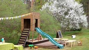 outdoor kid play area with house sandbox and slide learning by