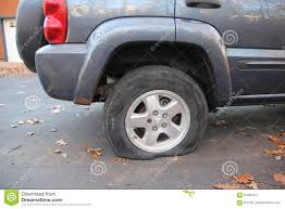 flat gray jeep flat tire editorial photography image of leaves pavement 87981412
