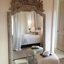 ornate white washed wooden floor mirror