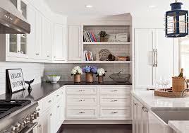 white kitchen cabinets with black quartz white kitchen cabinets with mixed countertops transitional