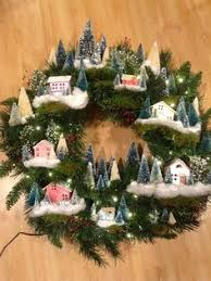 martha stewarts wreath with putz houses and bleached trees