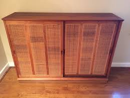 mid century walnut cabinet w rattan door panels at epoch