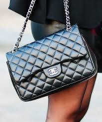how to spot a fake bag knockoffs guide the real real