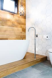 gorgeous bathroom timber feature panelling behind free standing