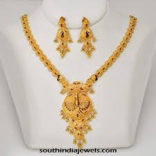 gold necklace with earrings images Latest model gold necklace with earrings south india jewels jpg