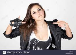 Cool Stock by Young Woman Wearing A Leather Jacket With A Cool Pose Stock Photo