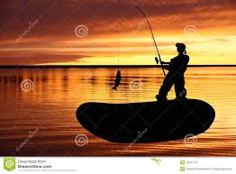 fisher woman into a fishing boat with catching fis royalty free