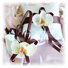 wedding flowers orchids chocolate brown wedding basket and pillow with orchid flowers